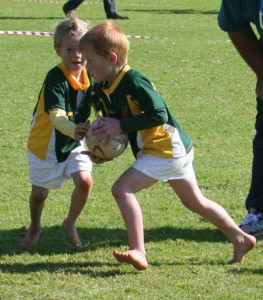 Two boys playing rugby